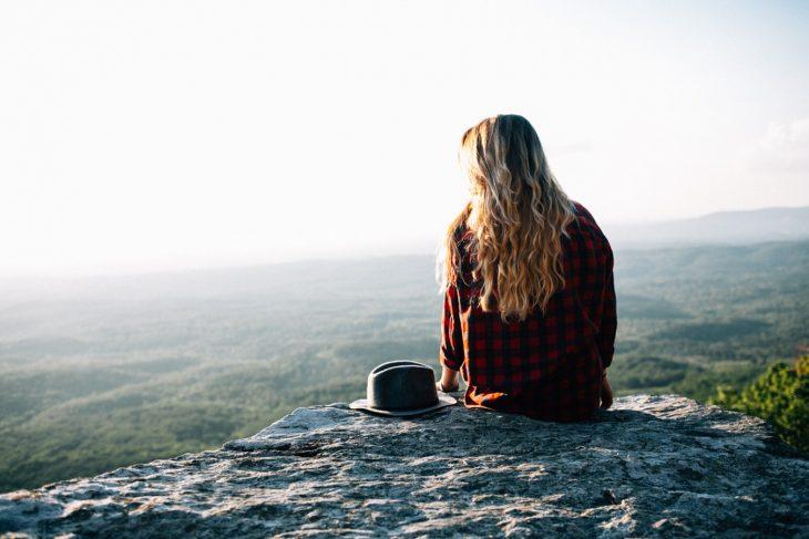 Girl thinking on rocks